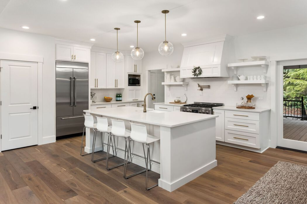 Large white kitchen with gold hardware