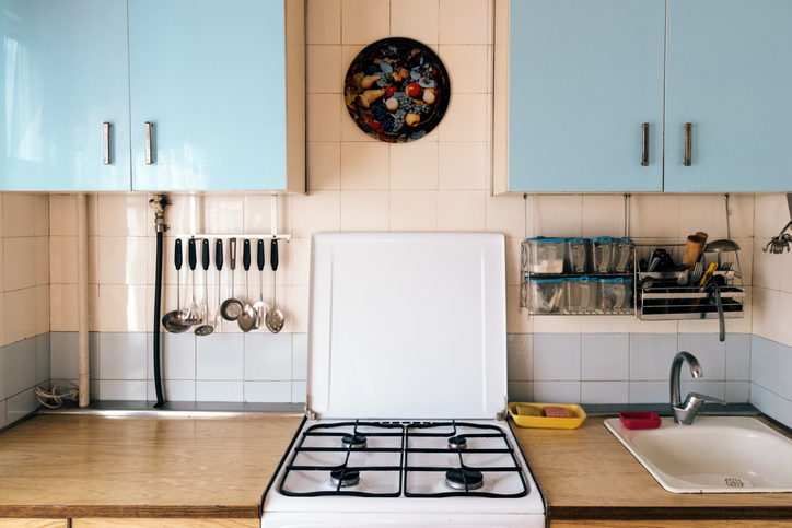 1960s-era kitchen with dated colours, countertop, and backsplash