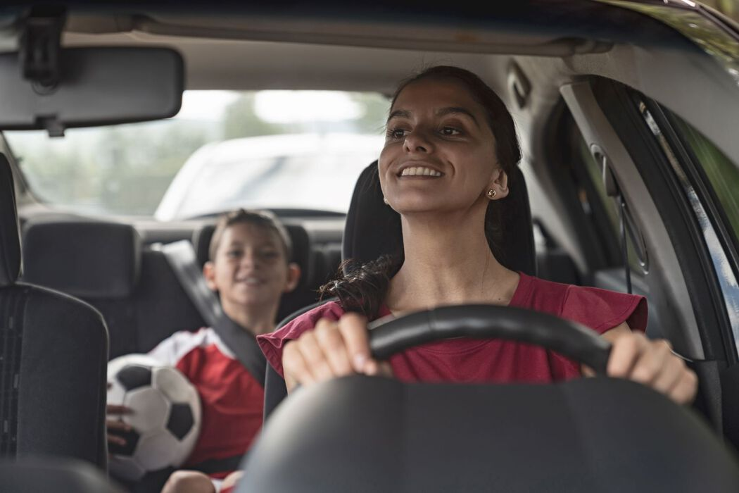 Mom driving son to soccer