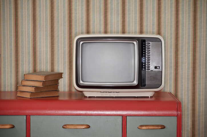 Room decor showing wallpaper, tv and chest from the 1970s