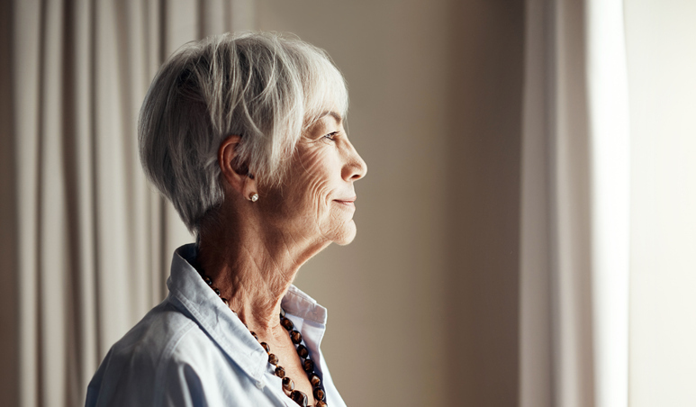 Woman looking gratefully out a window