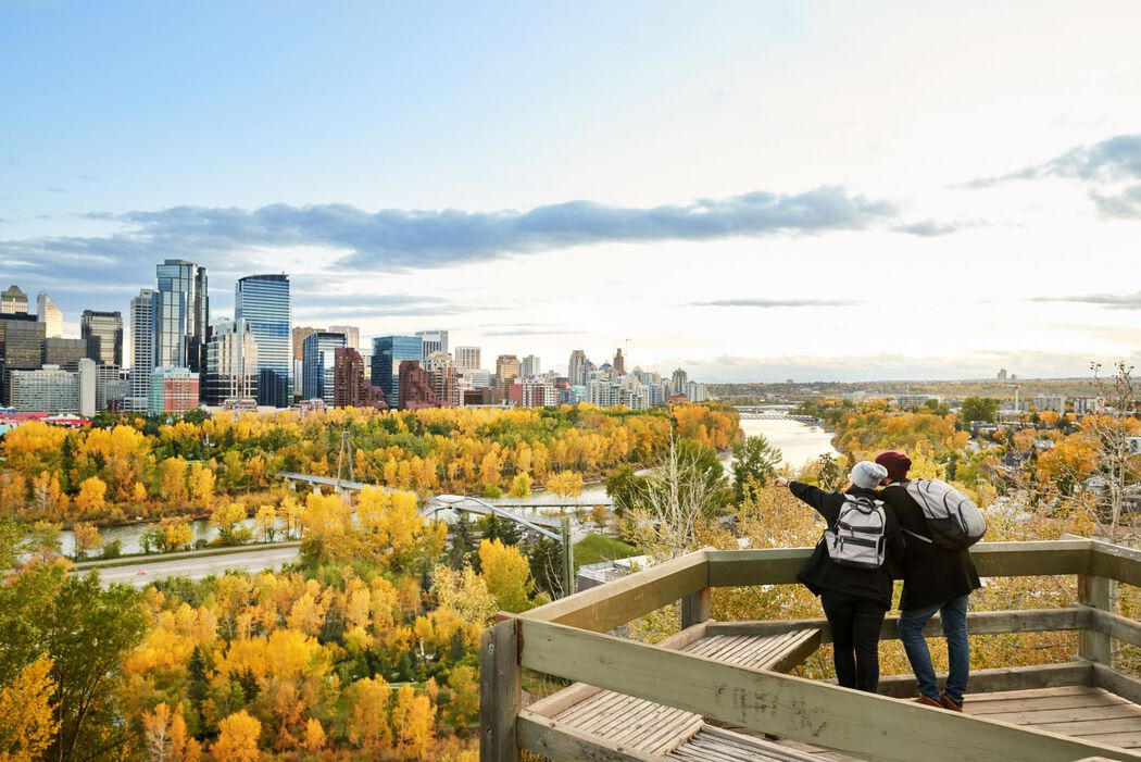 A couple overlooking the city of Calgary in fall