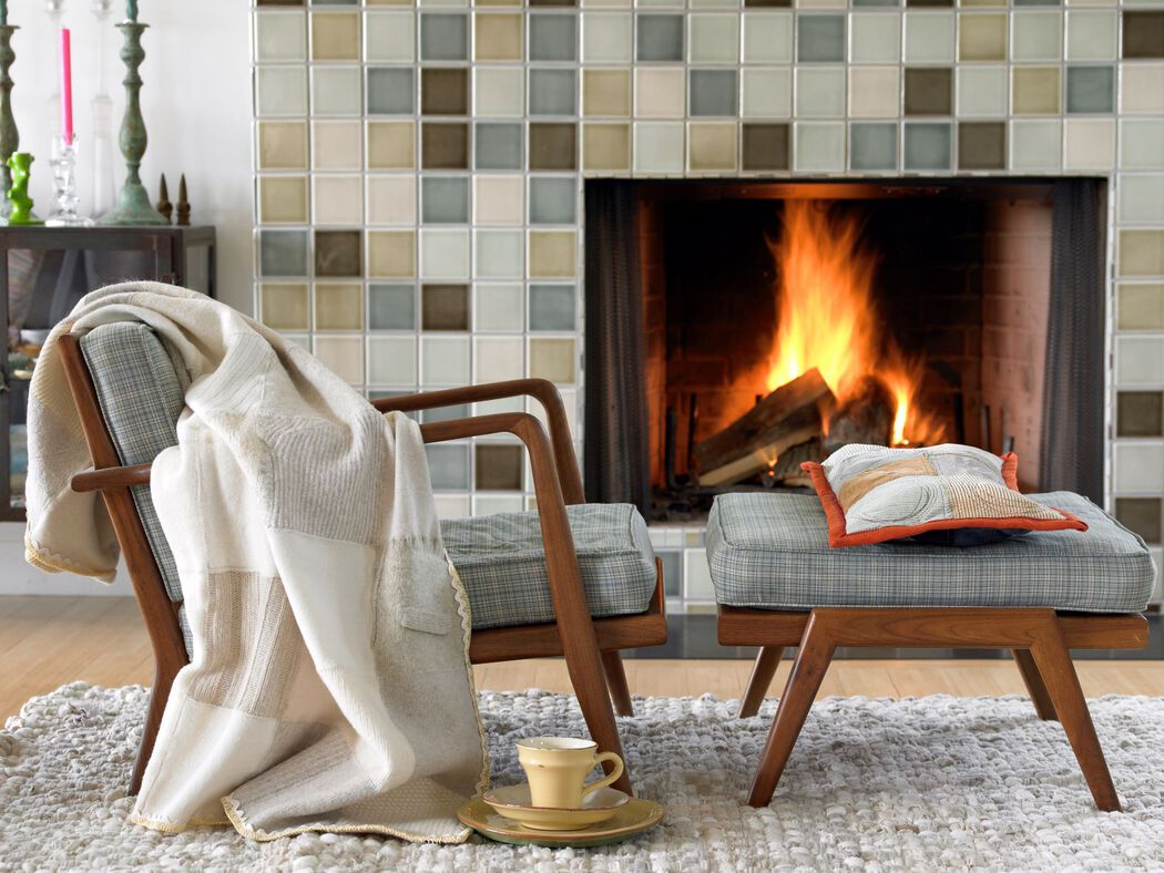 Cozy living room arm chair by the fire