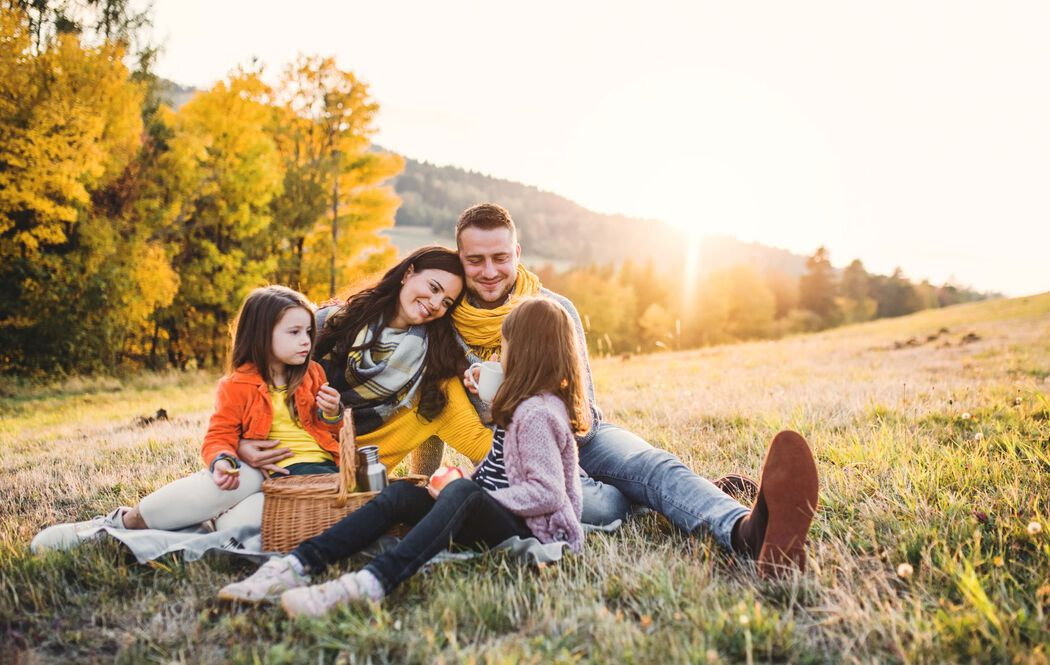 family having picnic outside in the fall