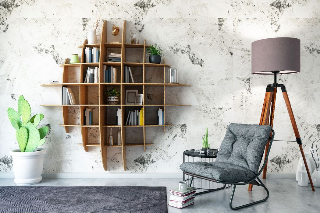 Reading nook with cactus, modern bookshelf, chair, and lamp