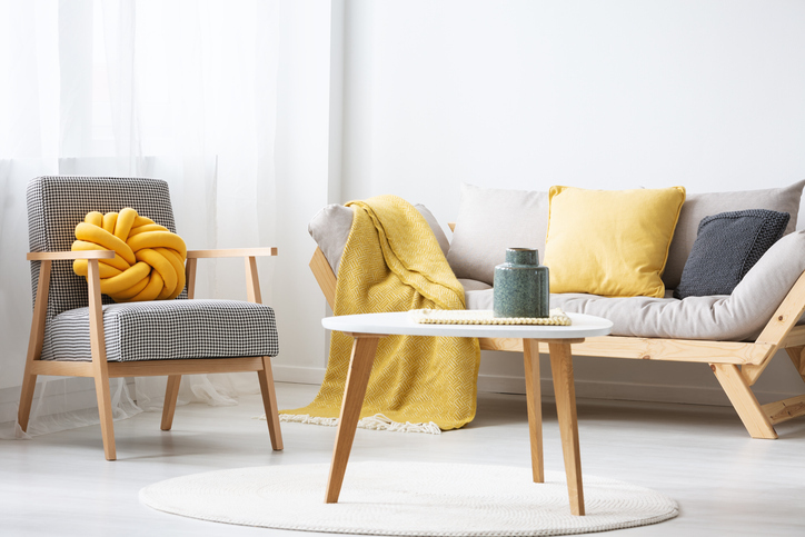 living room with pillows and throw creating a colour motif