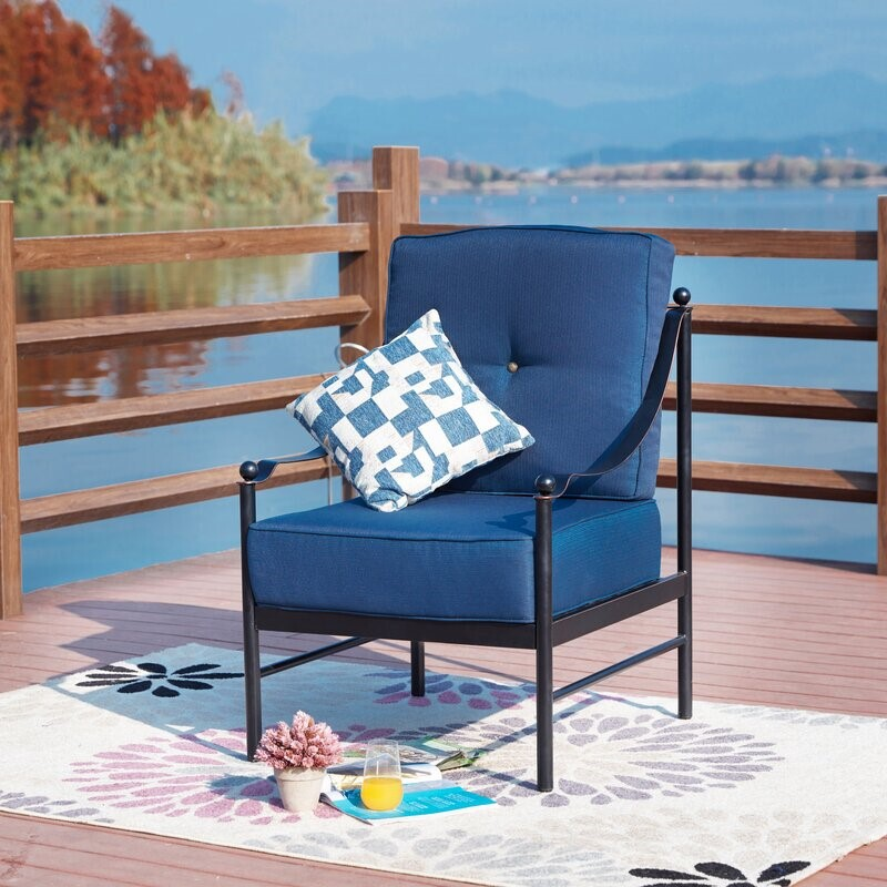 Blue patio furniture outside by lake