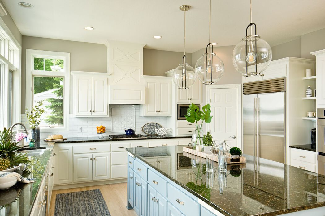 Contemporary white kitchen with modern lighting