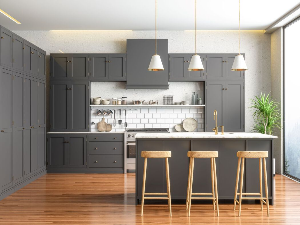 Contemporary gray kitchen with gold fixtures