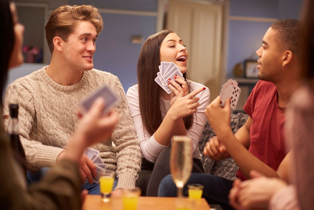 Friends drinking and playing cards