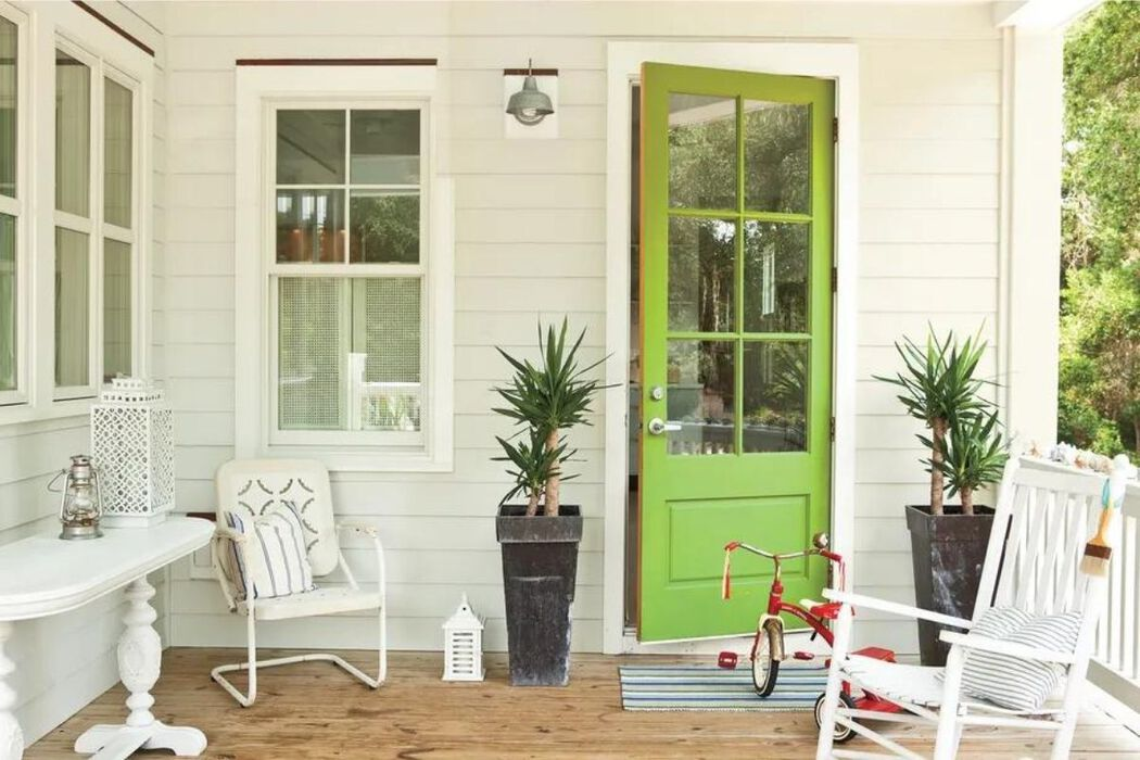 Front porch with an apple-green painted door
