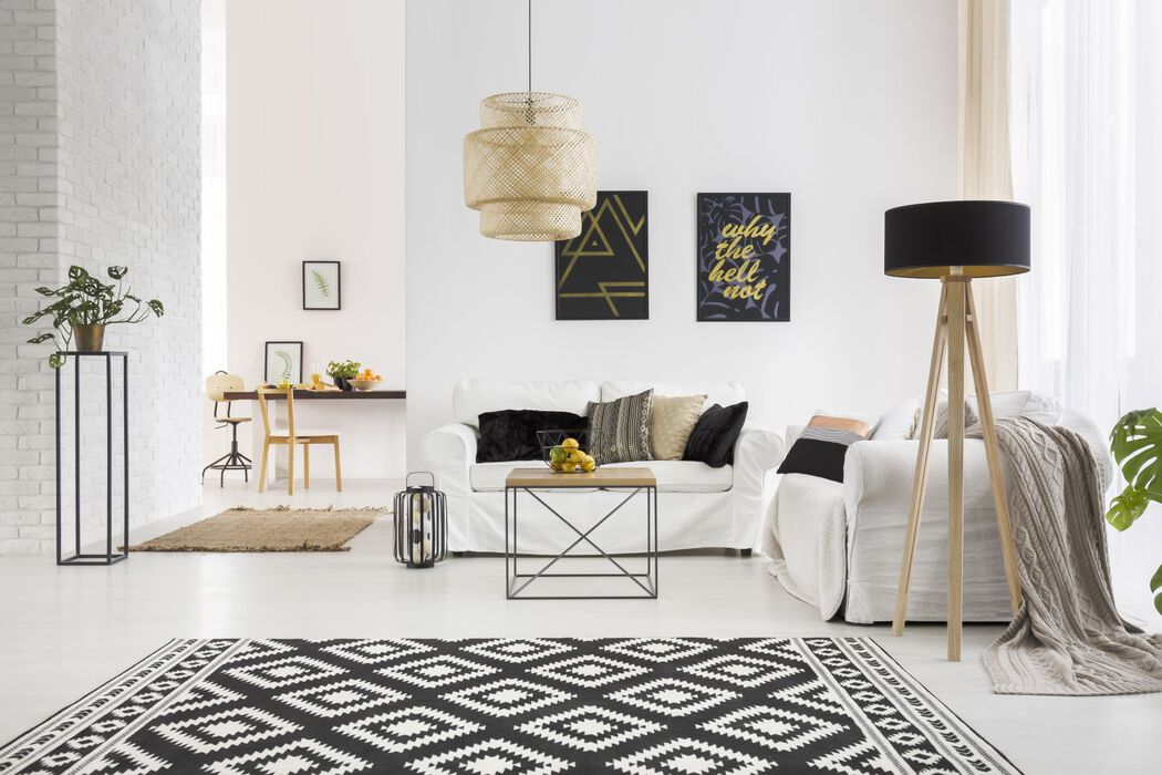 Modern living room in black, gold and white