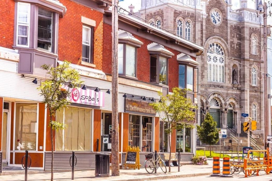 Image of storefronts next to a church in Hintonburg, Ottawa