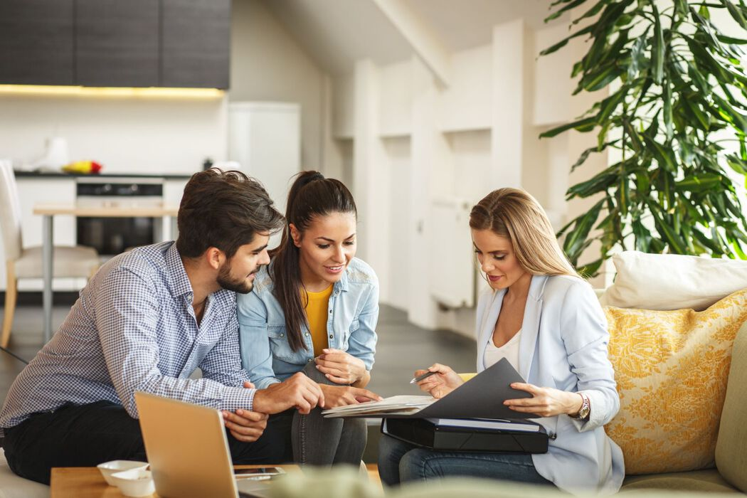 Young couple meeting with a real estate professional in a home