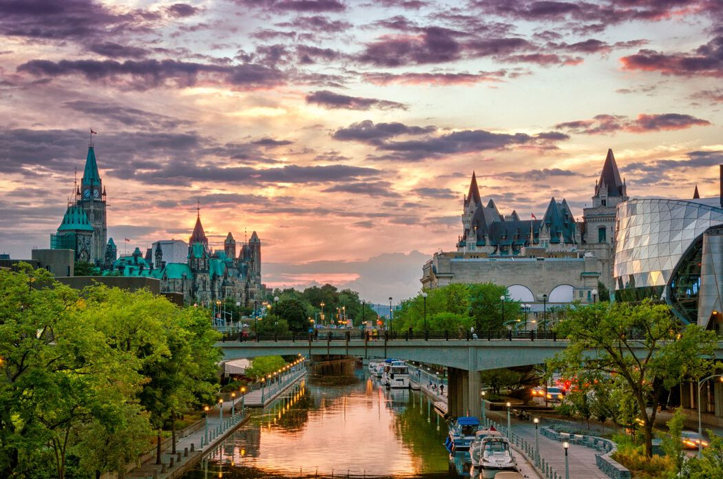 Cityscape of Ottawa with the canal running through it at dusk