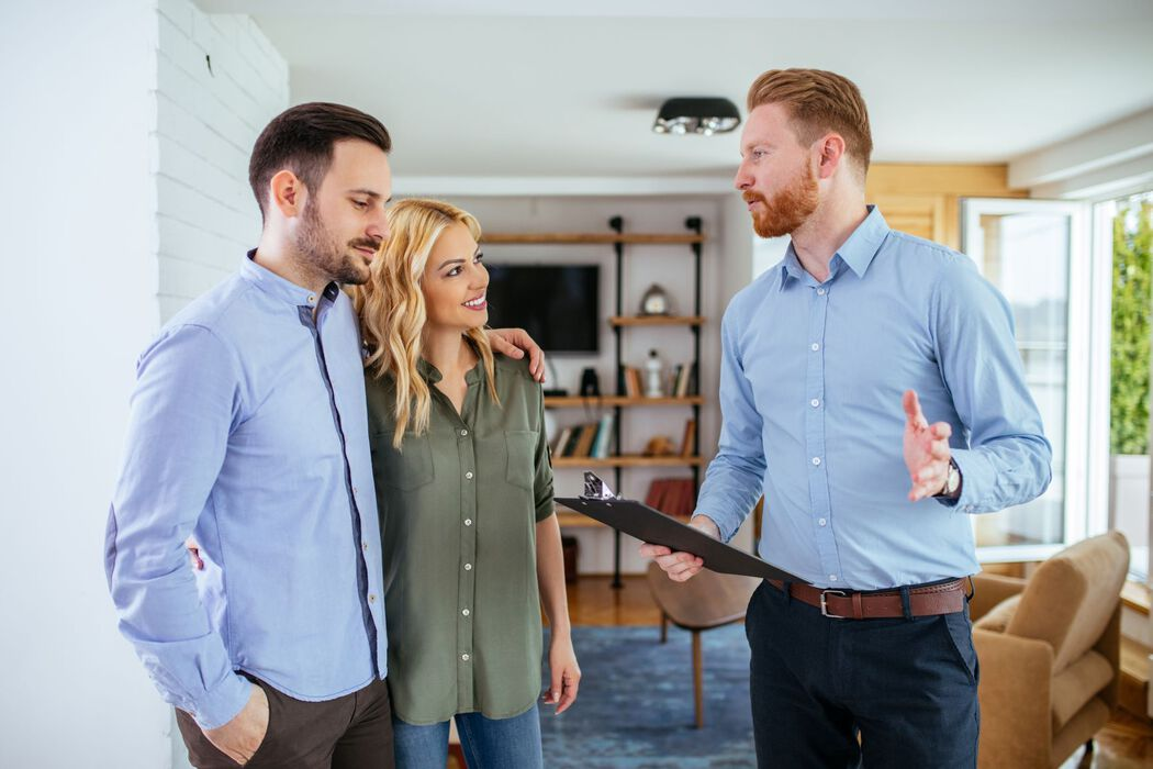 Couple meeting with a REALTOR in home