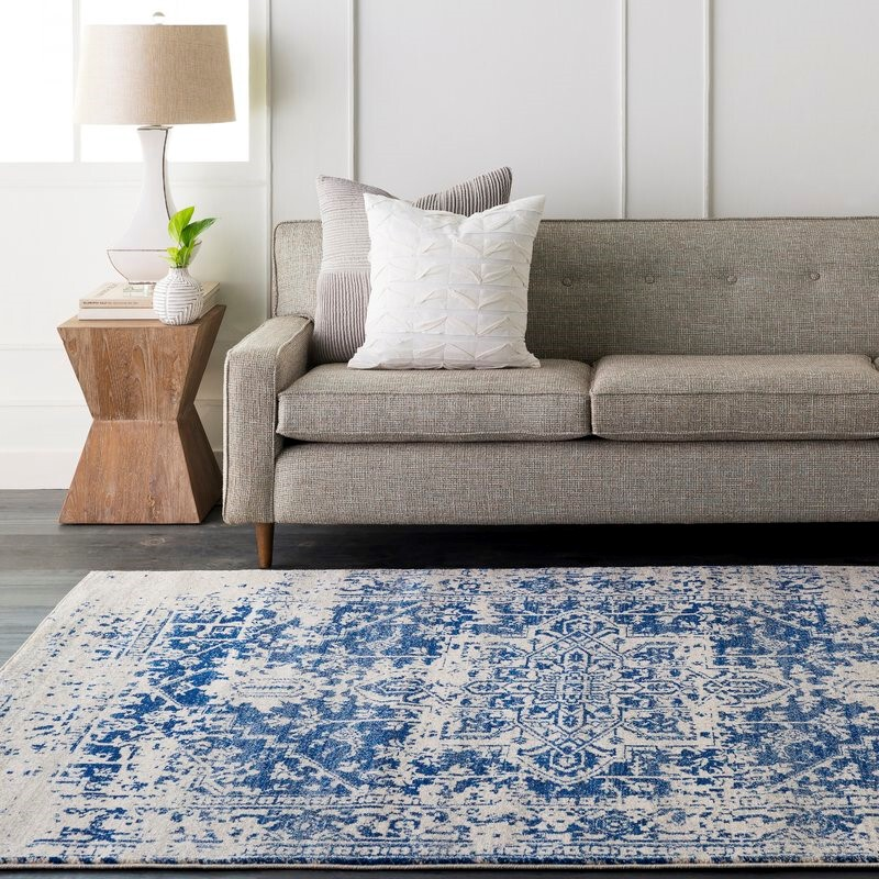 Blue and white rug in living room