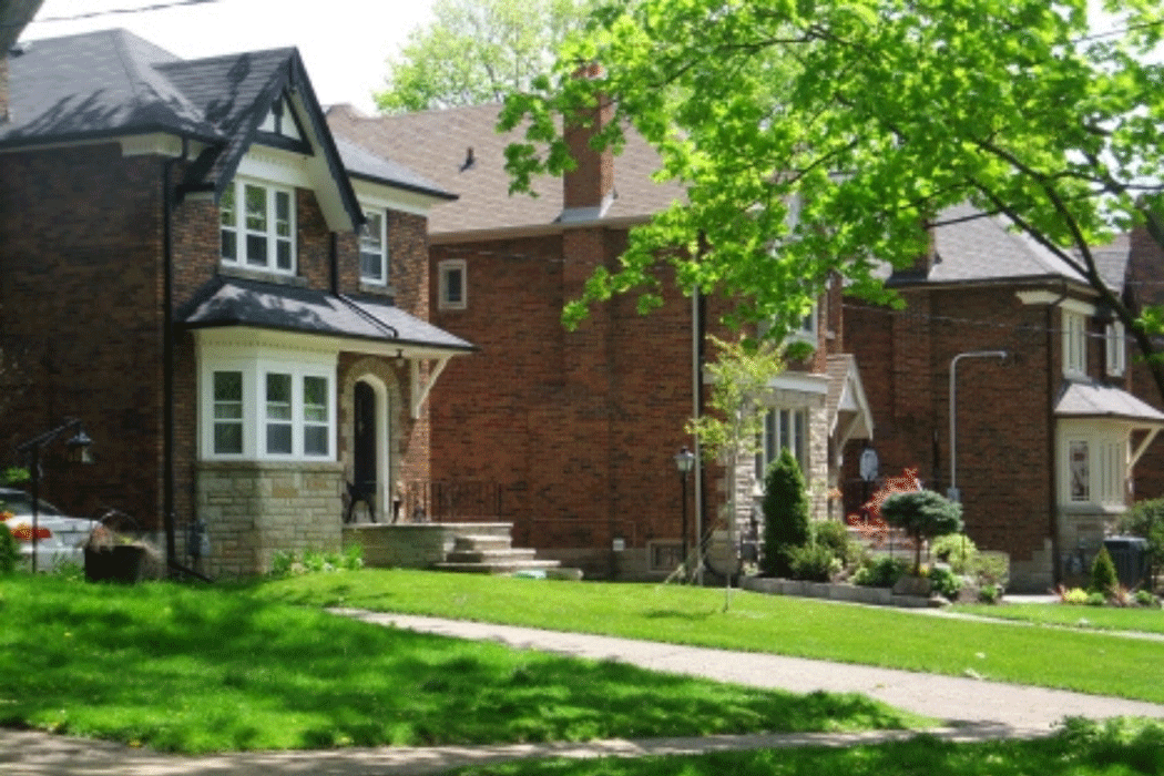 2-Storey brick houses lining a residential street in Leaside, Ontario