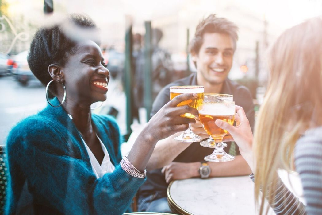 Young professionals enjoying drinks at a trendy pub