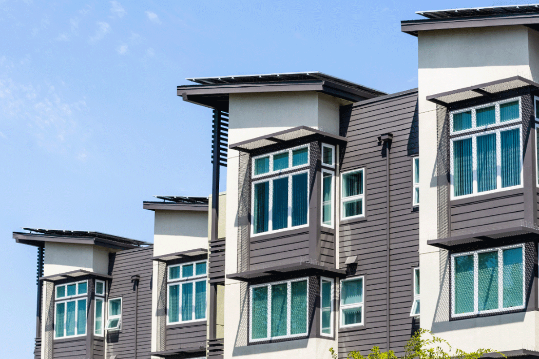Stucco and wood cladding on a the front of a condo