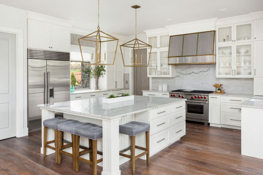 Contemporary white kitchen with gold accents