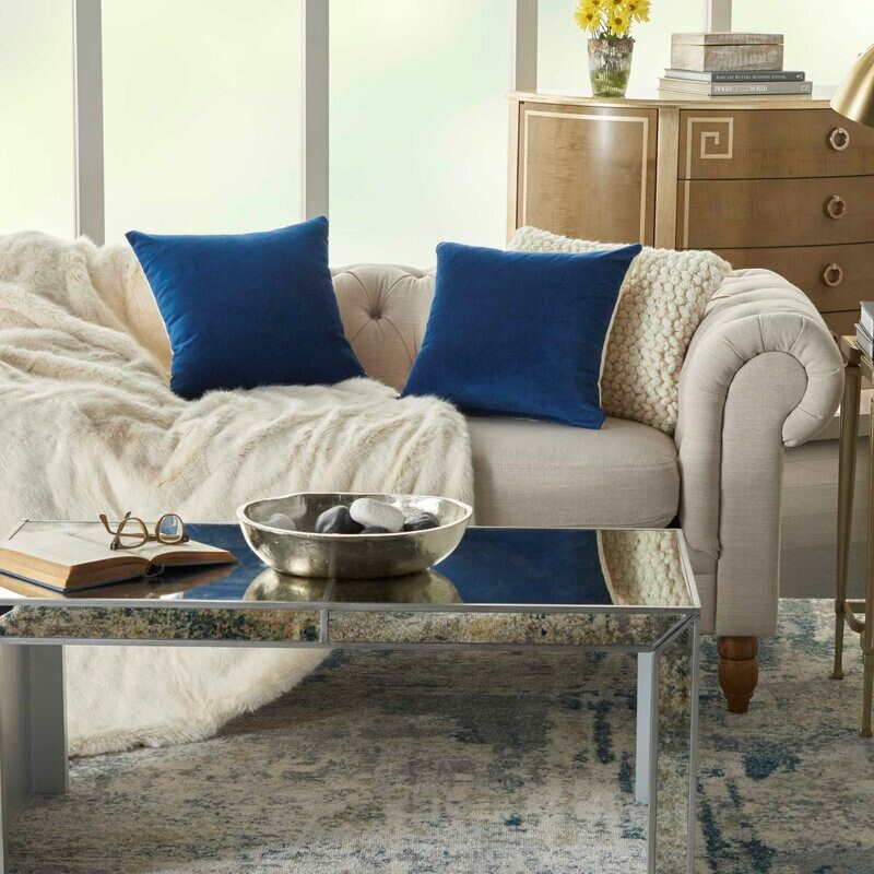 Blue pillows on white couch