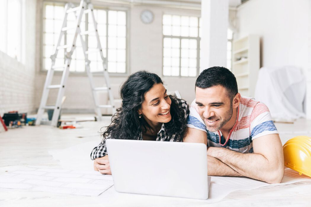 Couple on Laptop During Home Repairs
