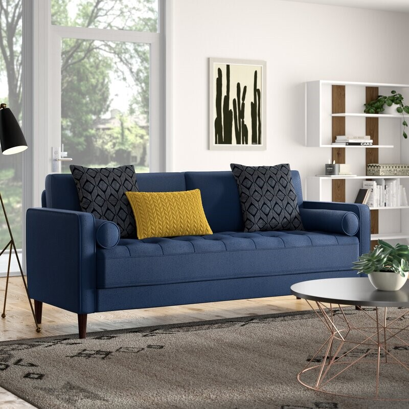 Blue couch with accent pillows