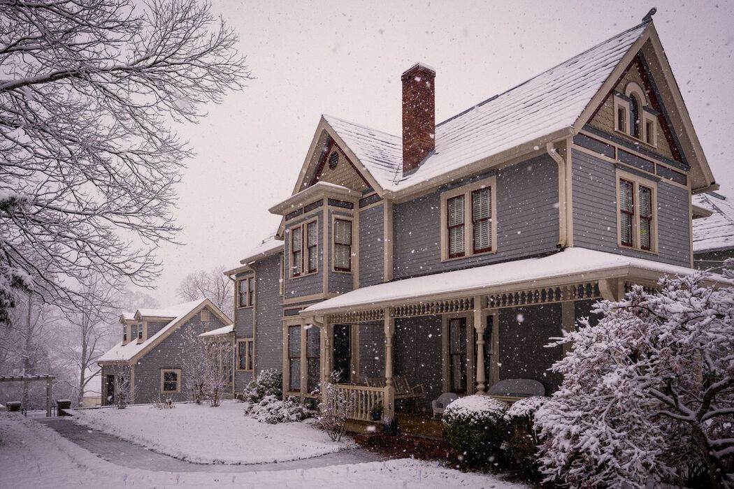 Victorian house during snowfall