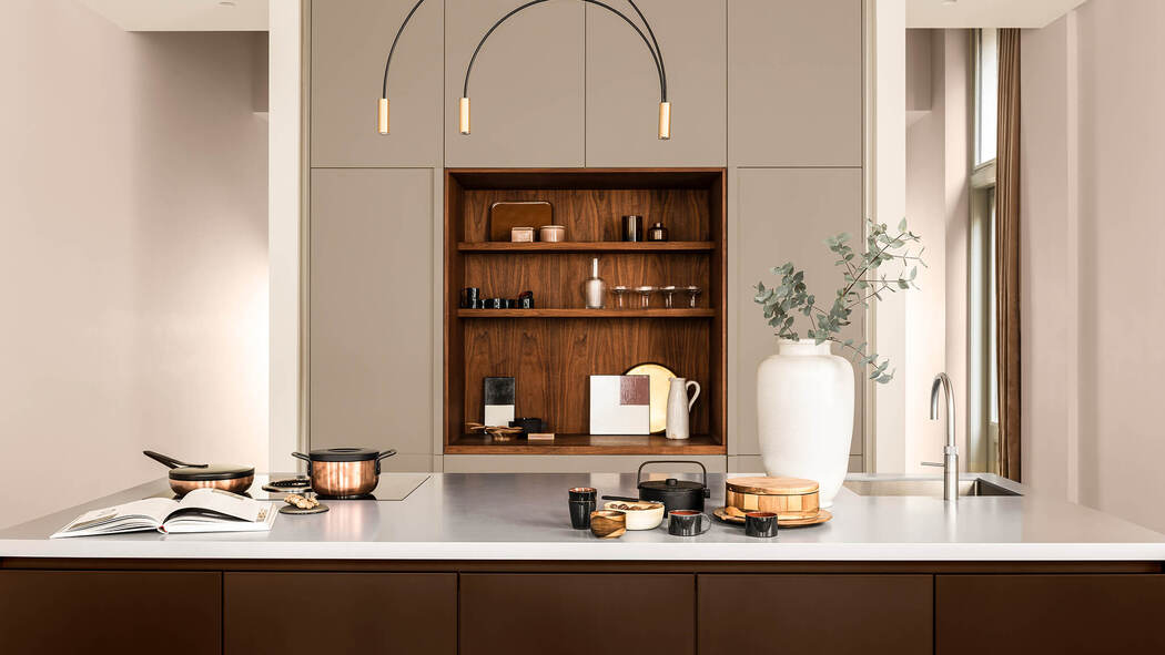 Warm-hued kitchen with cabinets painted in Dulux's Colour of the Year,