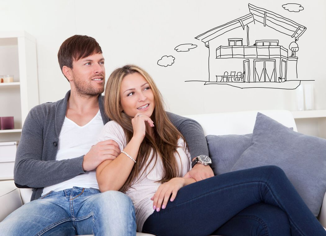 Couple imaging future house with a thought bubble over their heads with house as a line drawing