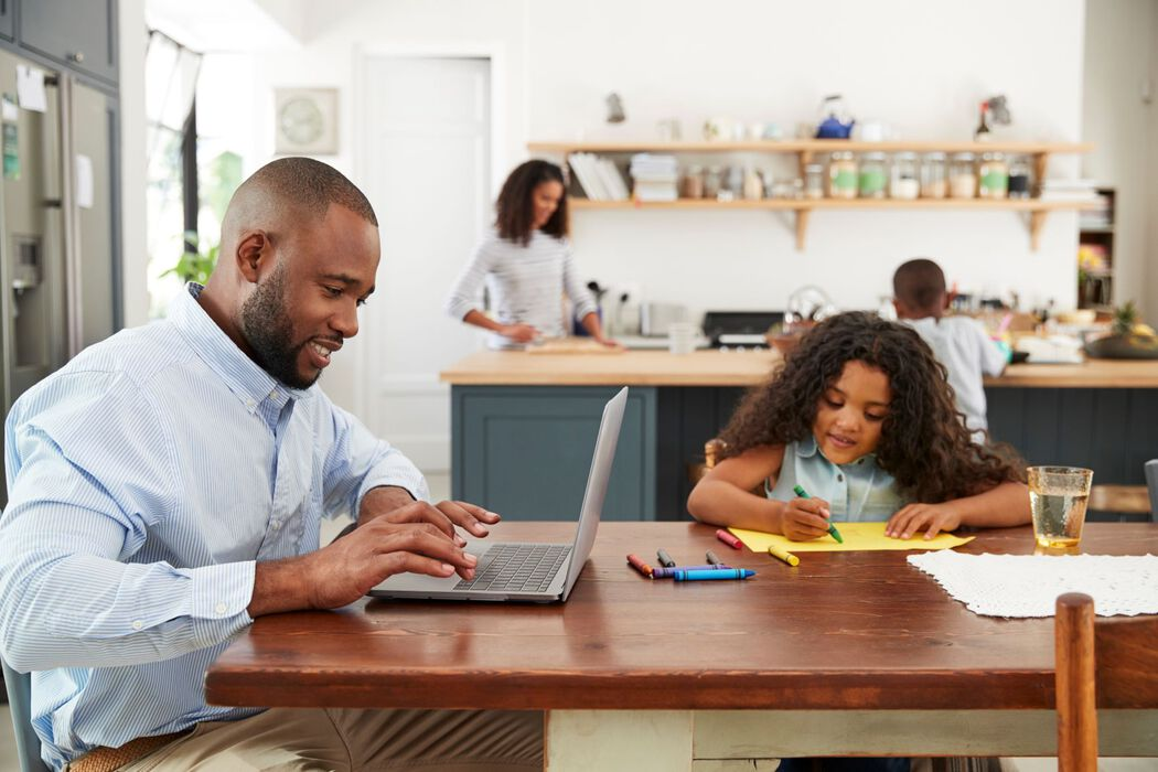 Working from home with kids - dad and daughter