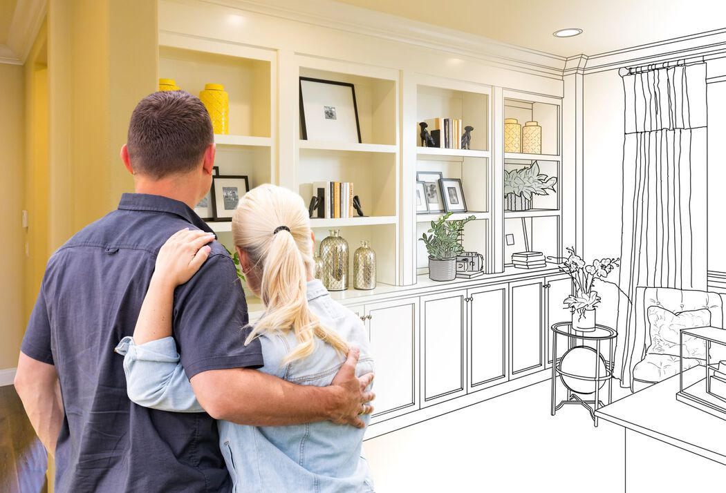 Couple looking at room with imaginative built-in shelves